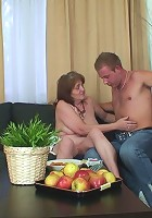 Granny on the couch taking his dick